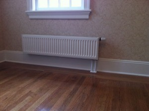 Hot water panel radiators. They are an alternative to baseboard heat or cast iron radiators.